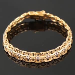 Armband guld 18 k X-länk med vitguldsinläggningar