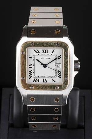 Cartier Santos armbåndsur af guld 18 kt. og stål