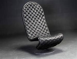 Verner Panton. Loungestol af sort læder, system 1-2-3