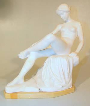 ERNST SEGER. Sitzender Frauenakt eine Sandale bindend, um 1900.