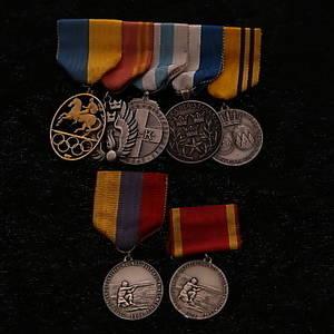 MEDALJER med tygfäste, 7 st, varav 6 st i silver, 1900-tal.